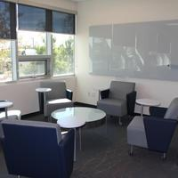 Arcadia Roaster Tablet Chairs, Encore Kenzie Table and Clarus Float Glassboard
